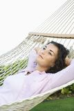 Woman in hammock. Royalty Free Stock Photography