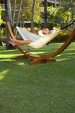 Woman on hammock Stock Image
