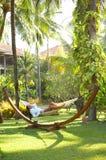 Woman on hammock Stock Image