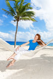 Woman in hammock on background of palm trees Stock Images