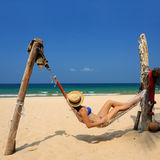 Woman in hammock on beach stock image