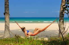 Woman in hammock on beach Royalty Free Stock Photo