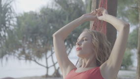 Woman on the hammock at the beach stock video footage