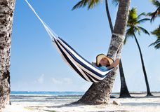 Woman in hammock at beach Royalty Free Stock Image