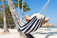 Woman in hammock at beach Royalty Free Stock Photography