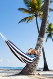 Woman in hammock at beach Stock Images