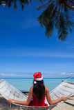 Woman in hammock celebrating Christmas Stock Images