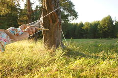 Woman on hammock in the forest Stock Image