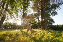 Woman on hammock in the forest Royalty Free Stock Images