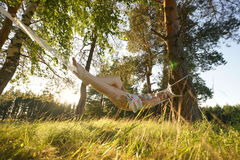 Woman on hammock in the forest Stock Photo