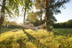 Woman on hammock in the forest Royalty Free Stock Photography