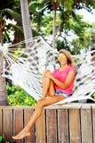 Woman in hammock Stock Photos