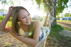 Woman on hammock in the park Royalty Free Stock Image
