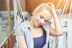Woman on a hammock on the terrace Stock Photography