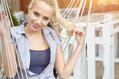 Woman on a hammock on the terrace Royalty Free Stock Photography