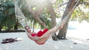 Woman in hammock on tropical beach at Samui island stock video