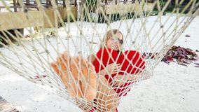Woman in hammock on tropical beach at Samui island stock video footage