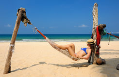 Woman in hammock on beach Stock Photography