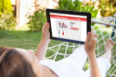 Woman On Hammock Using Digital Tablet Royalty Free Stock Photography