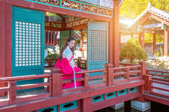 Woman with Hanbok in Gyeongbokgung,the traditional Korean dress. Stock Photo