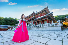 Woman with Hanbok in Gyeongbokgung,the traditional Korean dress. Royalty Free Stock Image