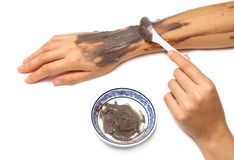 Woman hand applying spa cosmetic  clay cream Stock Images