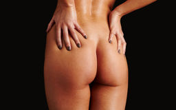 Woman hand on ass Royalty Free Stock Images