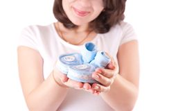 Woman hand with baby shoes Stock Photography