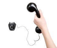 Woman hand with black retro telephone stock image