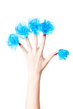 Woman hand with blue flowers on nails Stock Photo