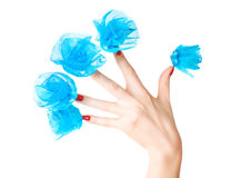 Woman hand with blue flowers on nails Royalty Free Stock Image