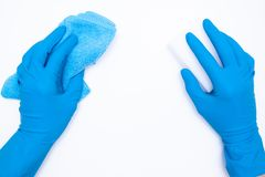 Woman hand in blue rubber gloves holds rag and sponge on white background. cleaning and regular clean up concept. Top view. flat royalty free stock photography