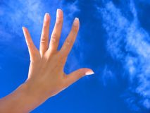 Woman / hand on blue sky Royalty Free Stock Photo