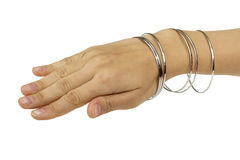 Woman hand with bracelets Stock Photos