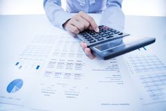 Woman hand and business report Stock Image