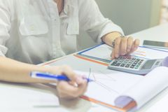 Woman hand calculate sales on the calculator royalty free stock images