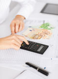Woman hand with calculator and euro money Royalty Free Stock Image