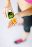 Woman hand with capsules Stock Photos