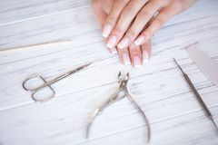 Woman Hand Care. Closeup Of Beautiful Female Hands Having Spa Manicure At Beauty Salon. Beautician Filing Clients. Healthy Natural Nails With Nail File. Nail royalty free stock photo