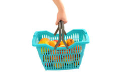 Woman hand carrying a full shopping basket. Royalty Free Stock Photos