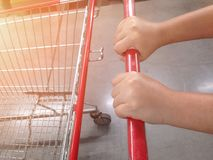 Woman hand cart holder in supermarket. royalty free stock photos