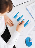 Woman hand with charts and papers Stock Image