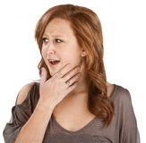 Woman with Hand on Chin. Awestruck woman with hand on chin over white Stock Photography
