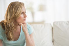 Woman With Hand On Chin Looking Away Royalty Free Stock Image