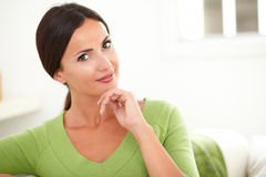 Woman with hand on chin looking at camera Stock Images