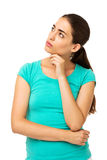Woman With Hand On Chin Looking Up At Copy Space Royalty Free Stock Photos
