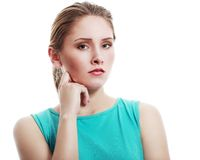 Woman with hand on chin Royalty Free Stock Photos