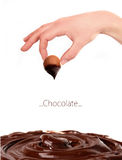 Woman hand with chocolate bonbon Royalty Free Stock Image