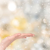 Woman hand on Christmas background Royalty Free Stock Photo