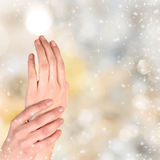 Woman hand on Christmas background Royalty Free Stock Image